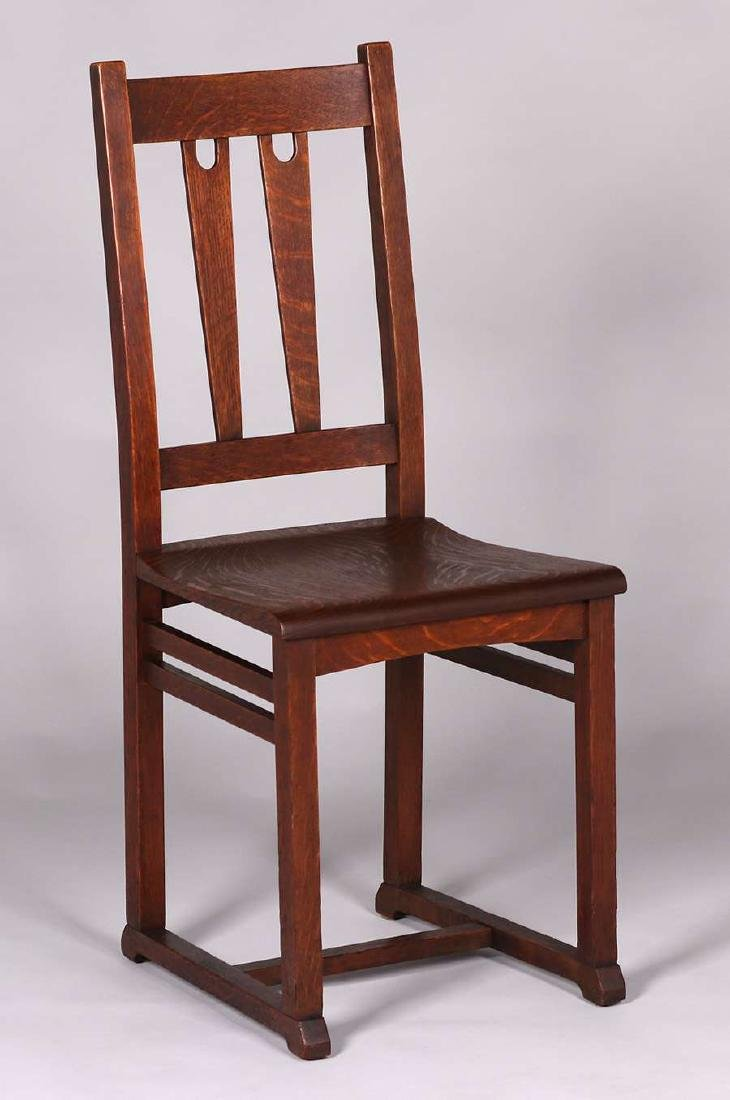 Rare Stickley Brothers cutout chair with shoe-feet.