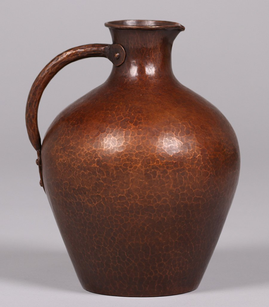 Early Dirk van Erp hammered copper pitcher c1911-1912.