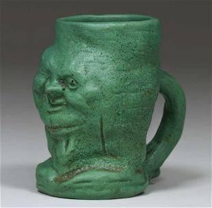 Wheatley Pottery Matte Green Face Mug c1910