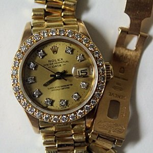 Lady's 18K Rolex - Oyster Perpetual DiamondDial