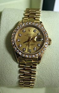 Lady's 18kt Gold Diamond Face Presidential Rolex
