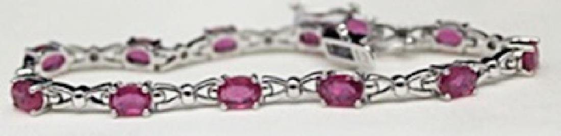Very Fancy Silver Bracelet with Pigeon Blood Rubies