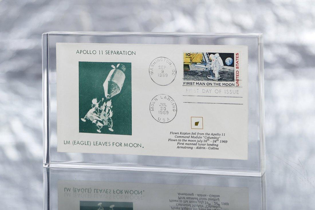 Acrylic containing an envelope with an Apollo 11