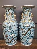 Pair of Large Chinese Turquoise Dragon Vases