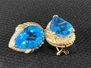 14 K Gold And Pear Shaped Blue Topaz Earrings