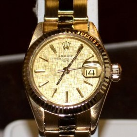 Lady's gold ROLEX Datejust watch with 14kyg case.