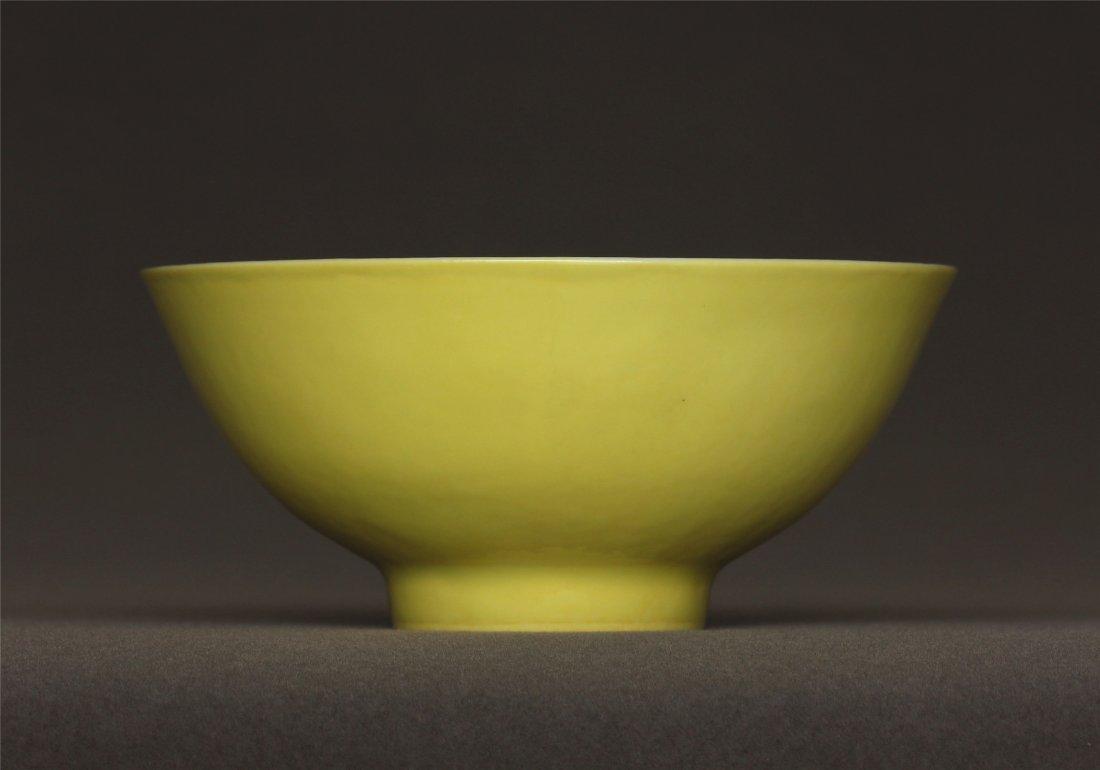 Lemon yellow glaze carved porcelain bowl of Qing