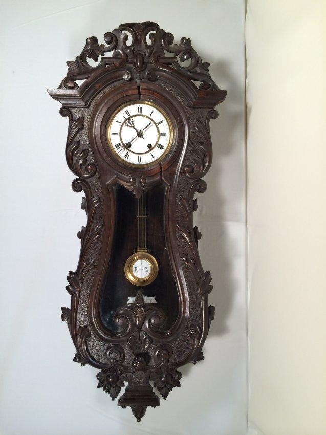 European antique hardwood carved wall clock.