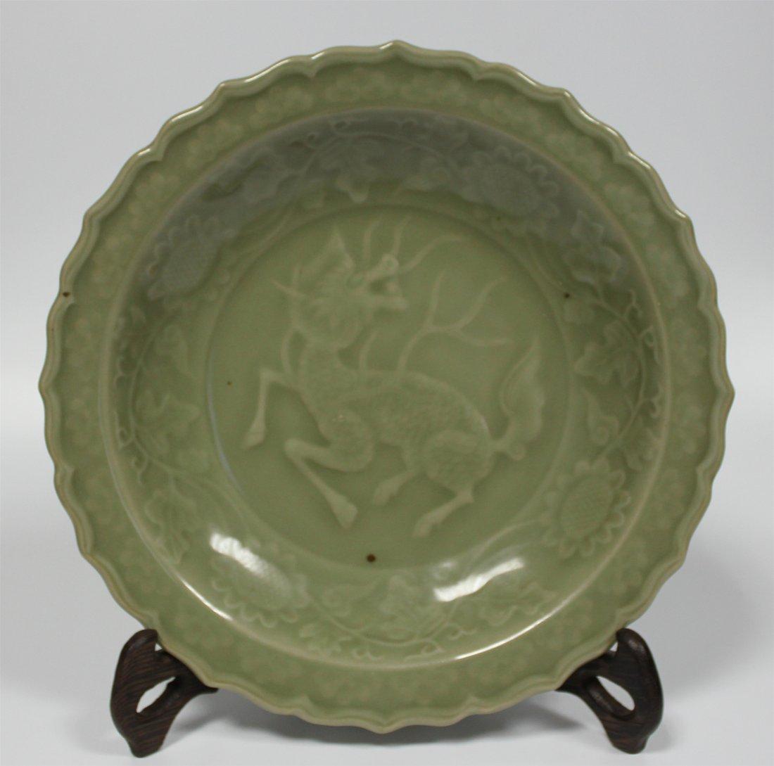 Chinese antique celadon porcelain plate .