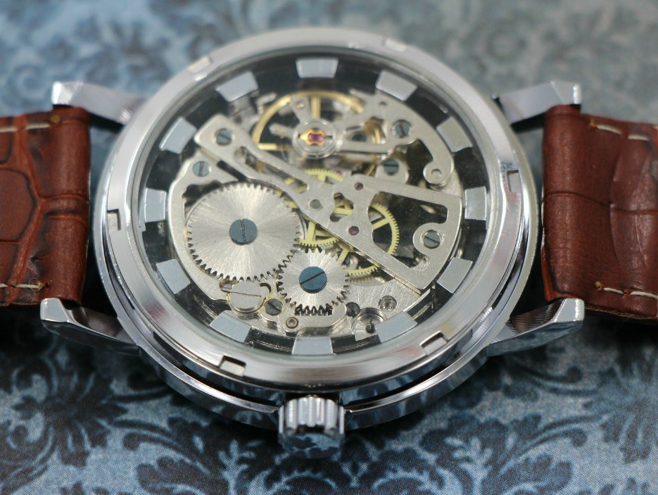 This is a Steampunk influenced watch with a clear back.