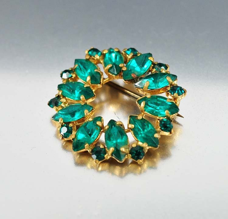 Brilliant emerald green foil backed rhinestones form a
