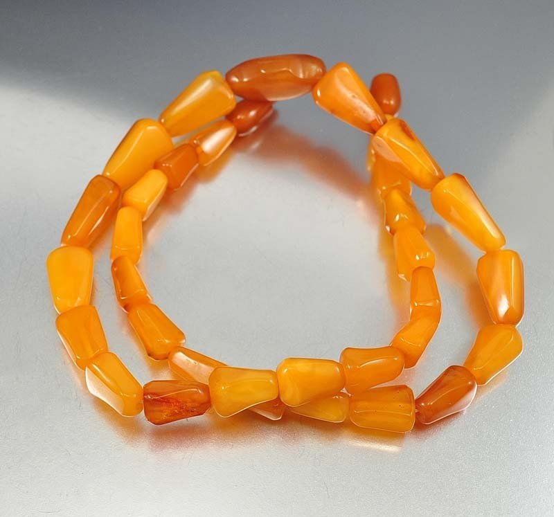 Amazing strand of vintage Art Deco era egg yolk butters