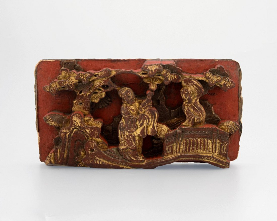 A RED AND GILT WOOD CARVING, 20TH CENTURY,