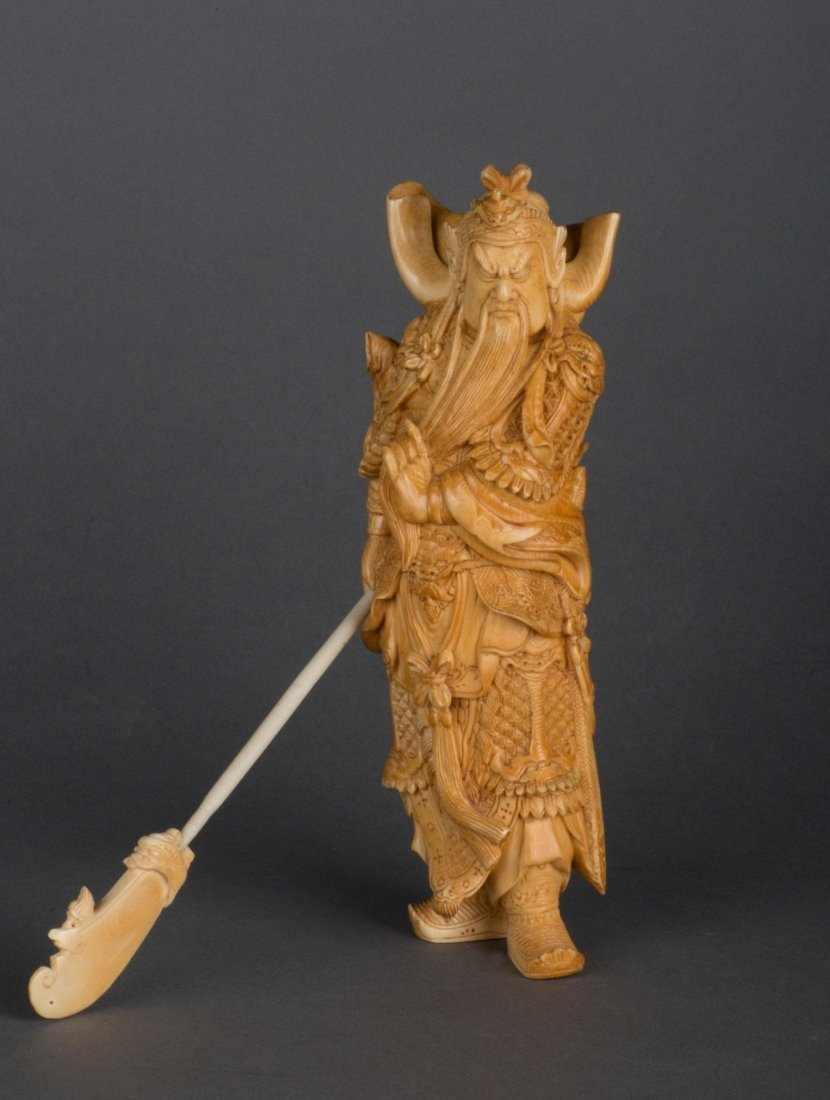 A VERY FINE IVORY CARVING OF GUAN YU WITH STAFF, QING D