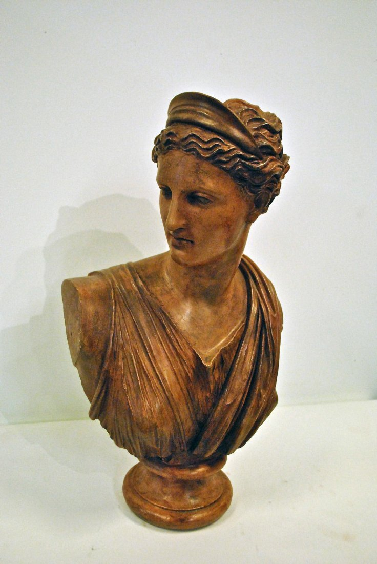 A TERRACOTTA BUST OF DIANA OF THE HUNT BY CHARLES OCTAV