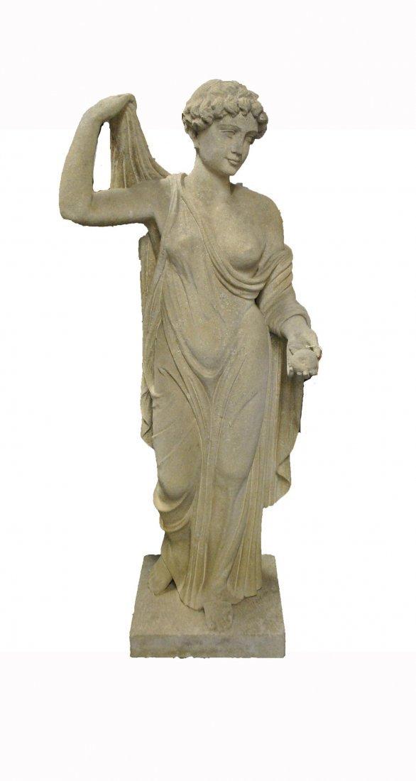 A SANDSTONE GARDEN STATUE OF VENUS HOLDING AN APPLE,