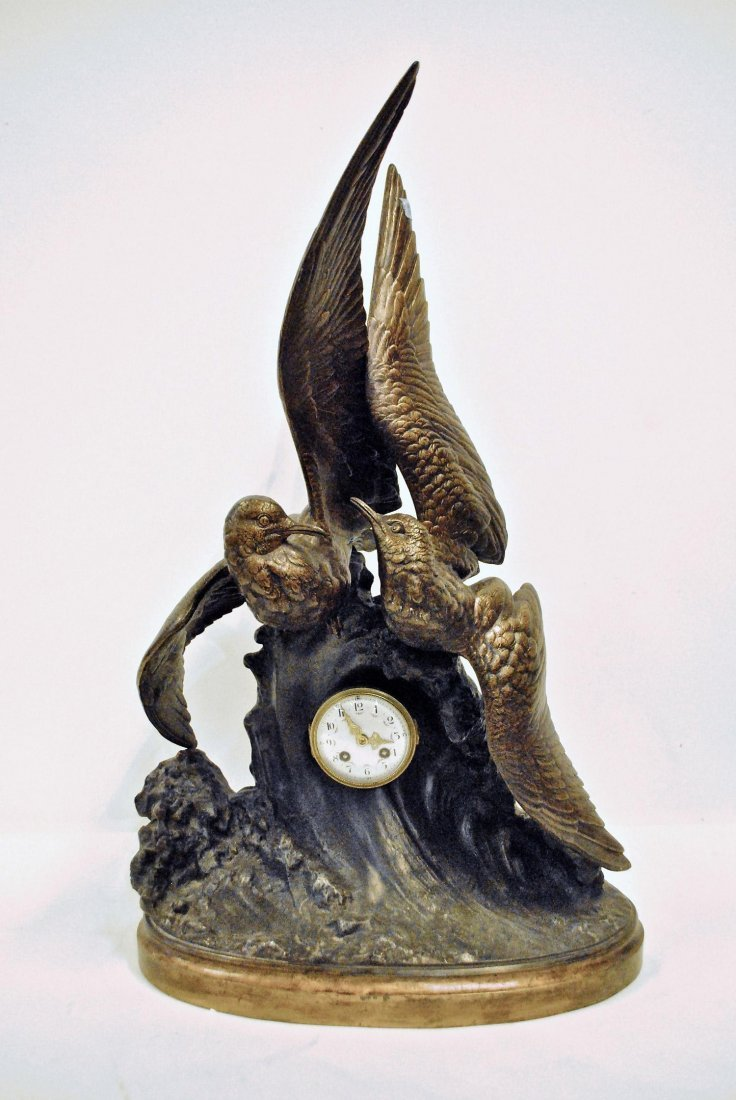 A BRONZE SEAGULL CLOCK,