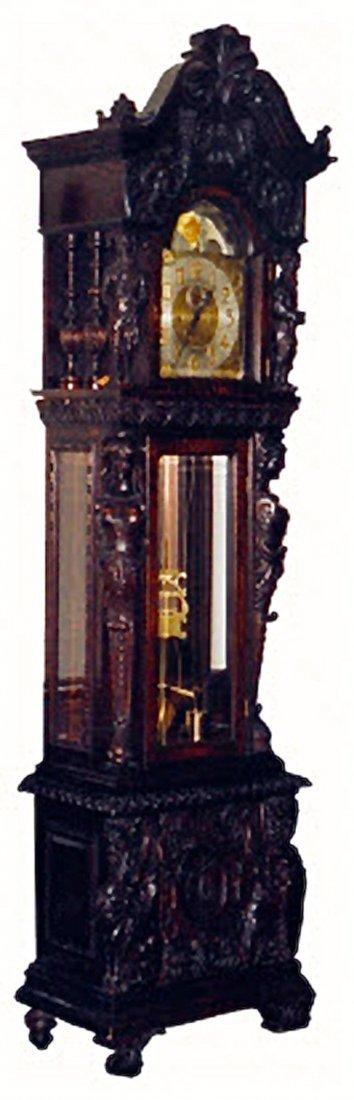 A LARGE OAKWOOD GRANDFATHER CLOCK,