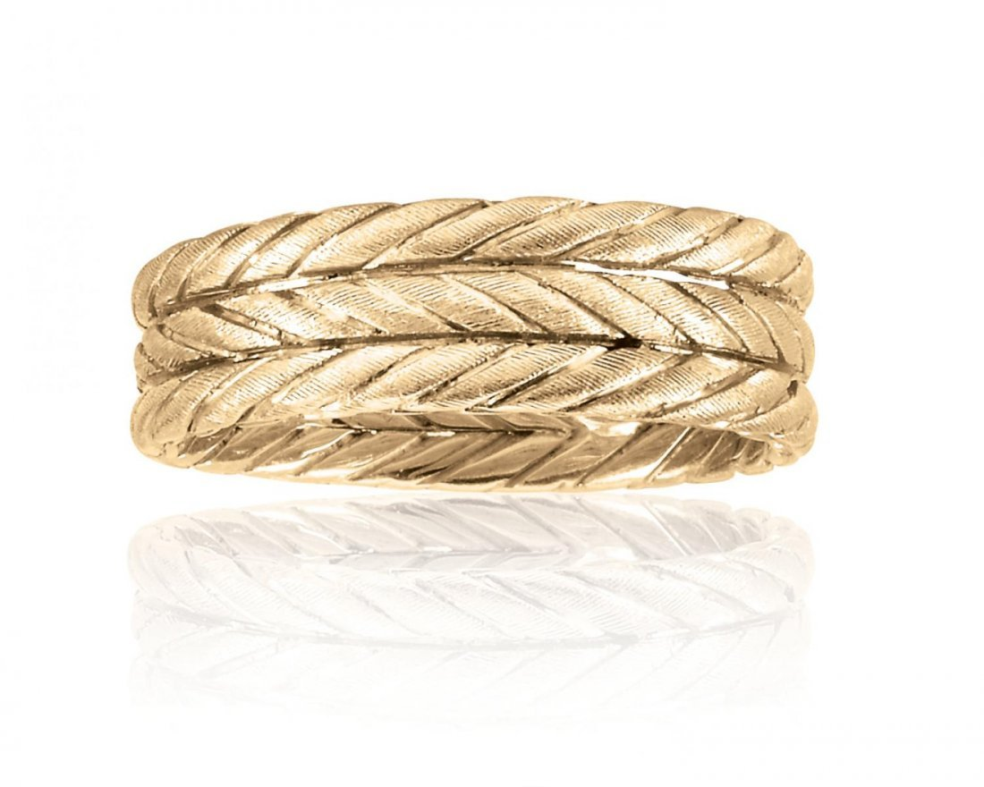 A textured gold ring stamped Buccellati