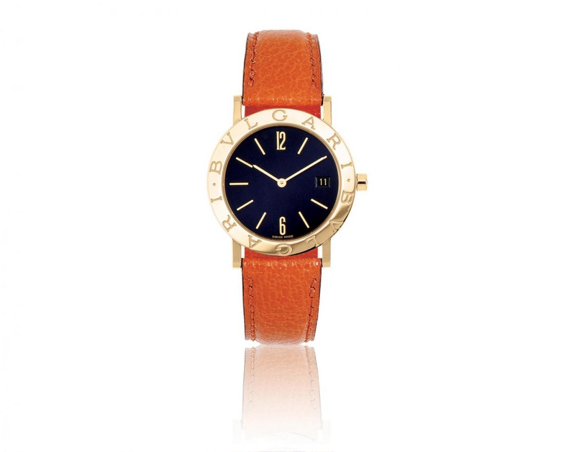 BVLGARI, A 33MM 18K GOLD DATED WRISTWATCH
