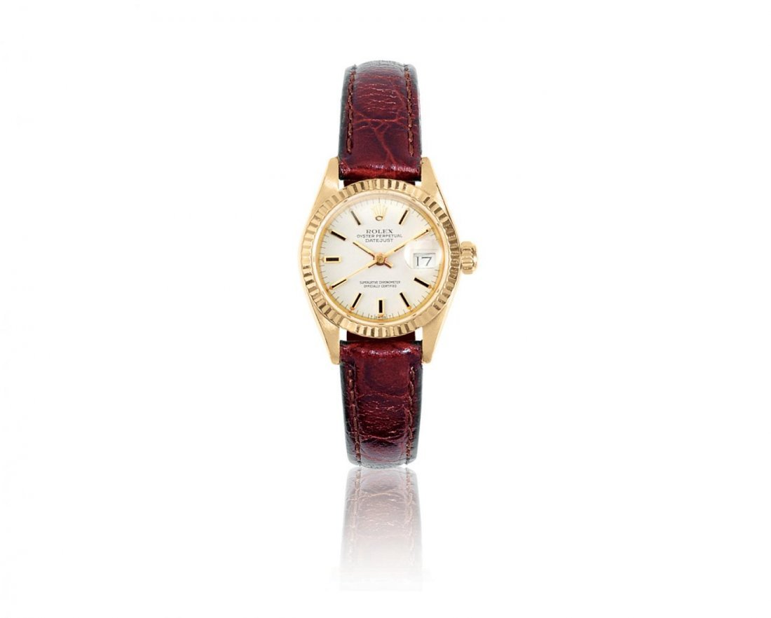 ROLEX, A LADY'S YELLOW GOLD AUTOMATIC CENTER SECONDS W