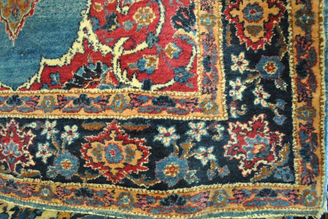 A SEMI-ANTIQUE PERSIAN HAND-KNOTTED KERMAN,