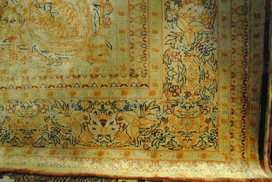 A SILK STAINED HAND-KNOTTED PERSIAN TABRIZ,