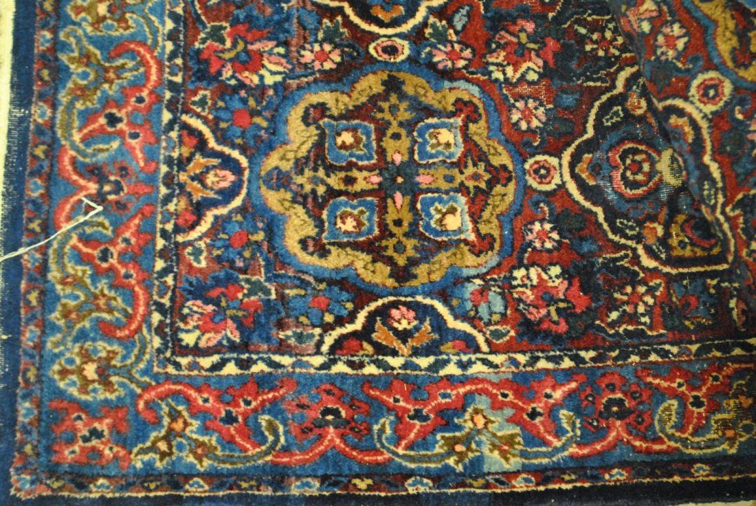 AN ANTIQUE HAND-KNOTTED PERSIAN , KERMAN SAROUK,