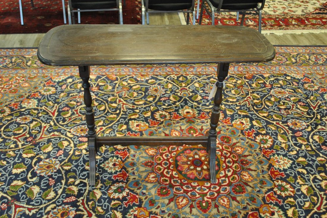 A SMALL OVOID SIDE TABLE,