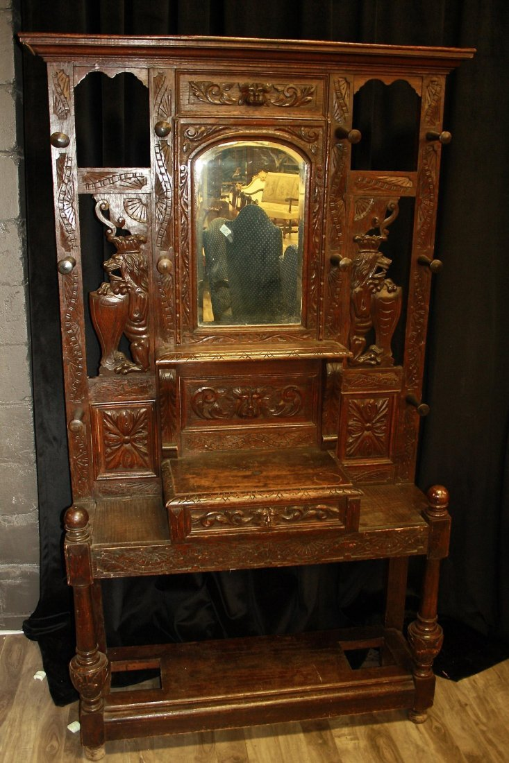 AN OAK-CARVED HALL STAND,