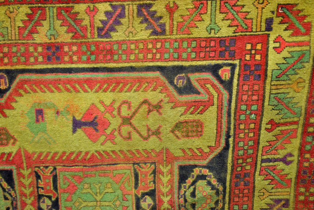 A FADED RED, GREEN, BLUE, AND PINK PERSIAN HAMADAN,