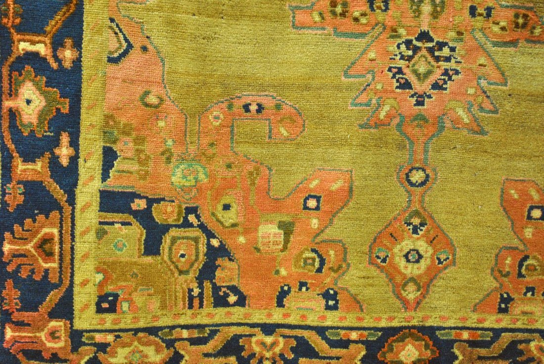 A BLUE, PINK, AND BROWN PERSIAN HAMADAN WITH A