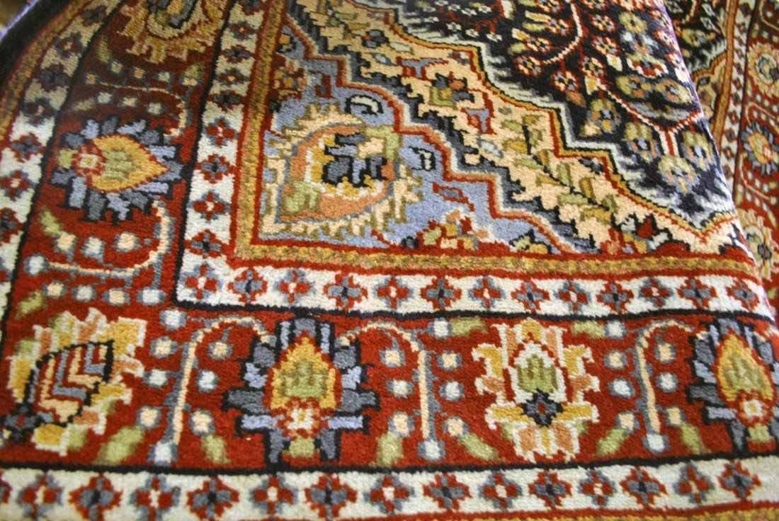 AN INDIAN AGRA RUG IN LIGHT BLUE, GREY, BRIGHT RED,