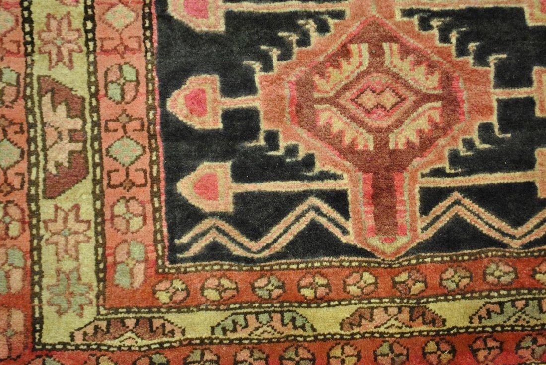 A BLACK, PINK, AND CREAM PERSIAN HAMADAN,