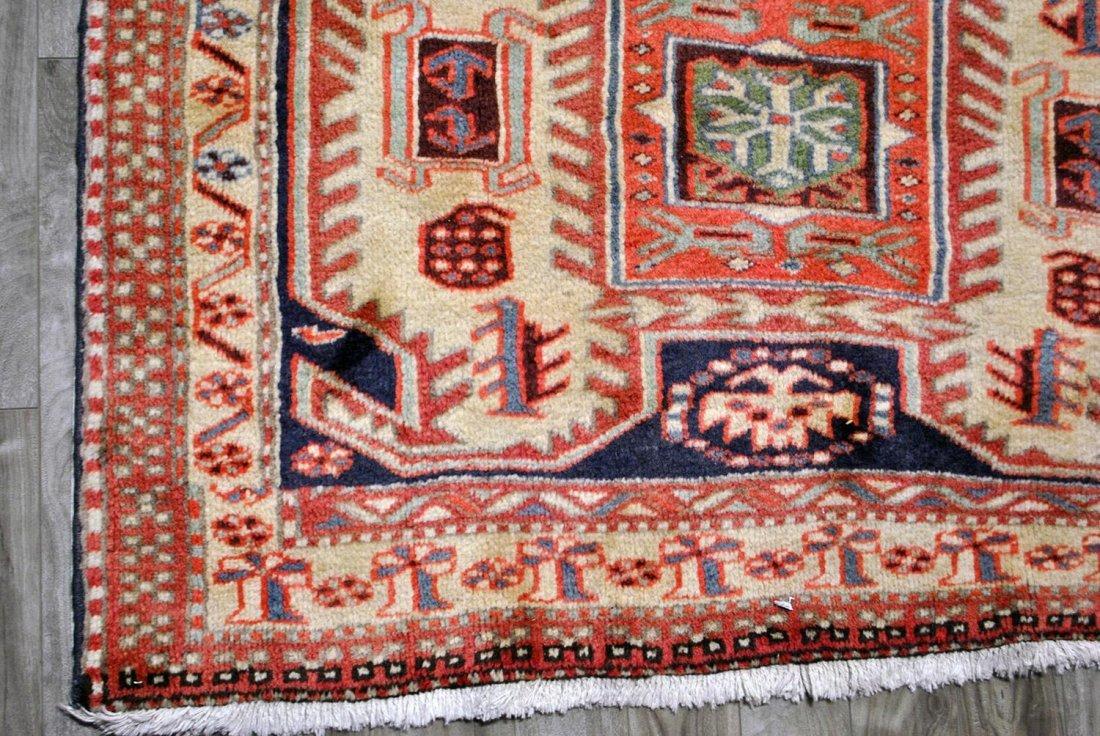 A CREAM, RED, BLUE, AND LIGHT GREEN PERSIAN HAMADAN,
