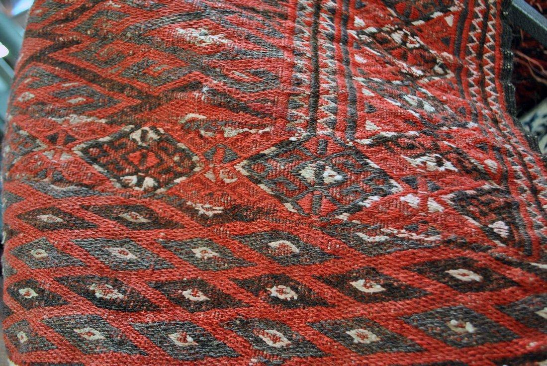 A RED AND BLACK YAMUT KILIM, TURKOMAN ORIGIN,