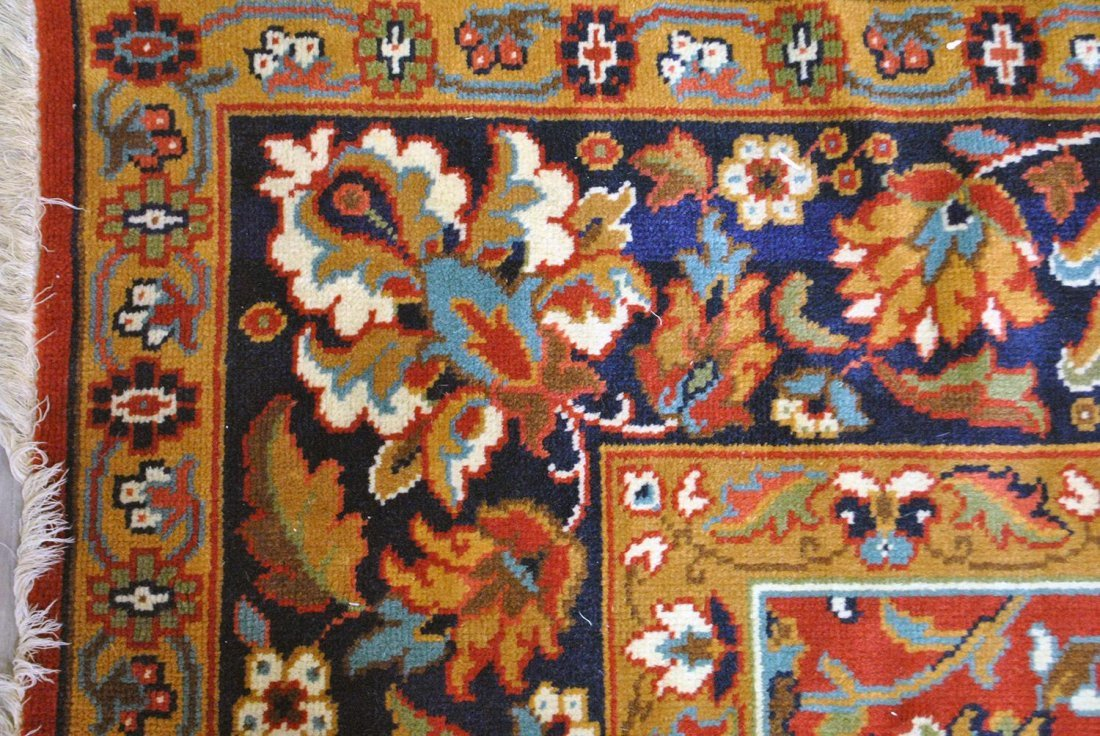 A BROWN, RED, PINK, AND GREEN INDIAN JAIPURI RUG,