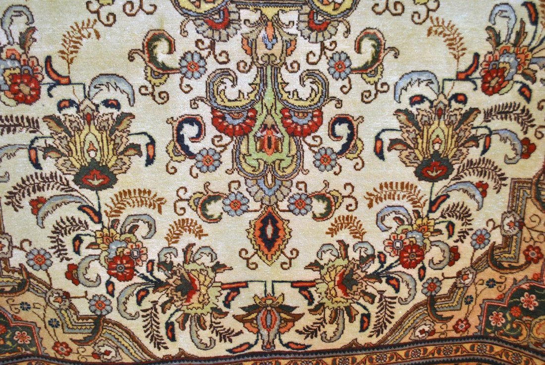 A RED, CREAM, YELLOW, WHITE, AND BROWN PERSIAN TABRIZ,