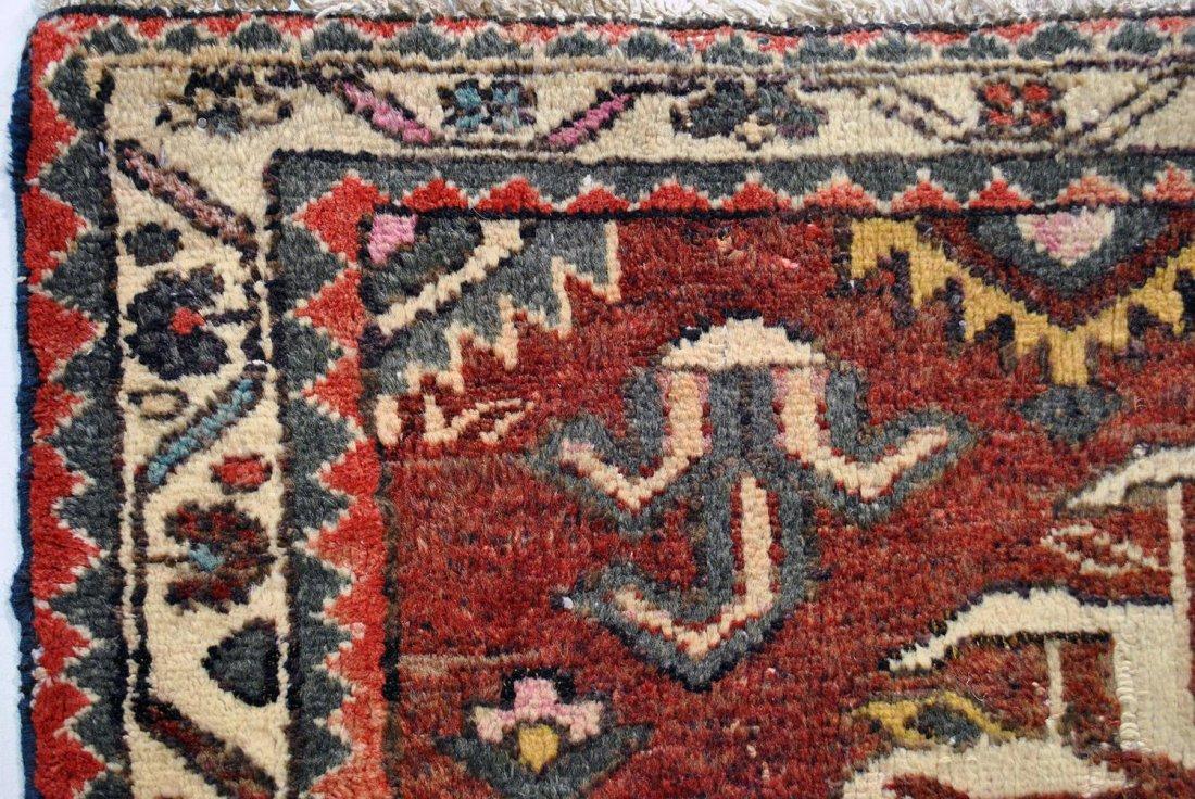 A RUST RED, GREEN, YELLOW, AND CREAM PERSIAN HAMADAN,