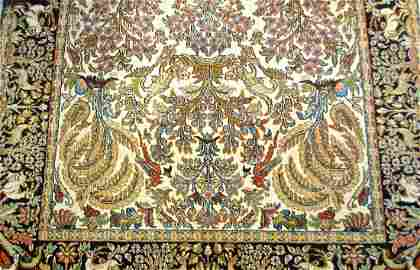 A KASHMIRI SILK ON COTTON RUG WITH ANIMAL MOTIFS