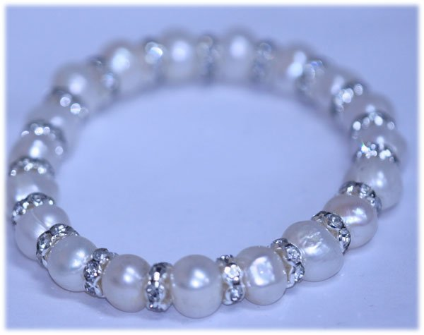 94.50 CTW WHITE PEARL AND CZ BRACELET