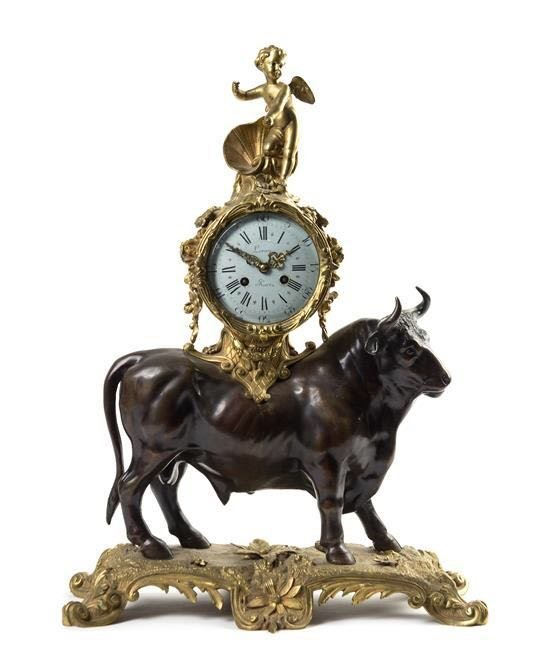 A French Gilt & Patinated Bronze Figural Mantel Clock