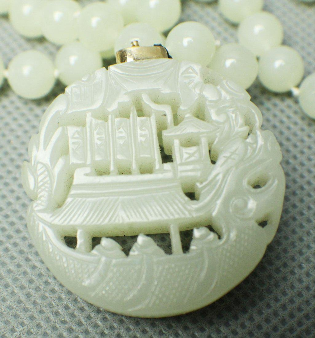 A HE TIAN ICE JADE IN OPENWORK CARVING