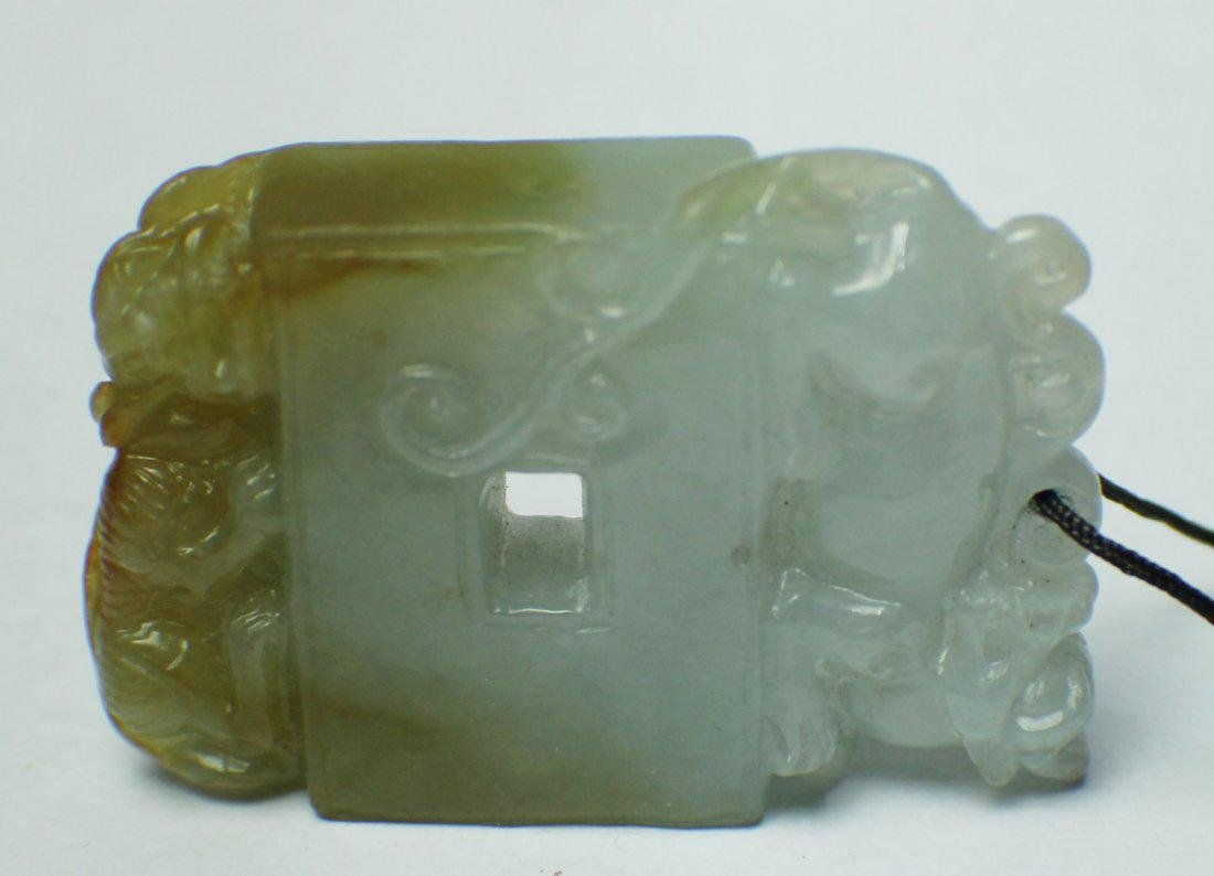 A JADEIT SQUARE PENDANT WITH ANIMAL CARVING