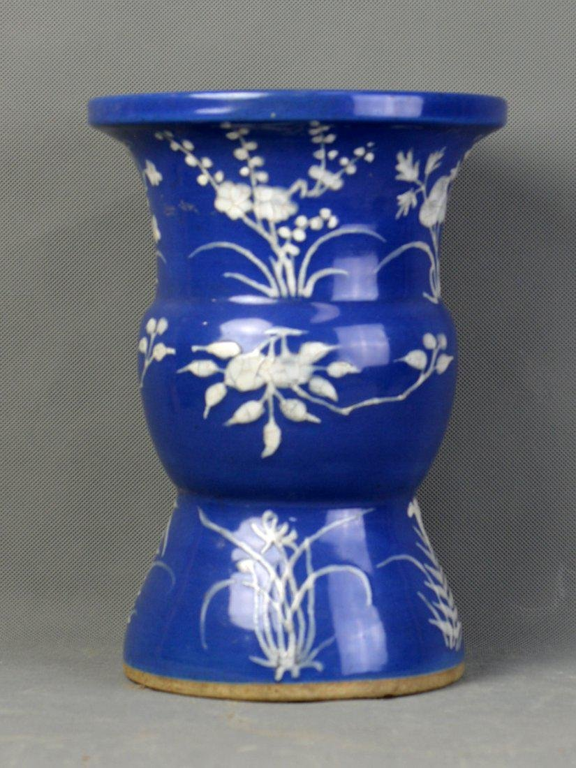 A Blue & White Hopper with White Flower Pattern