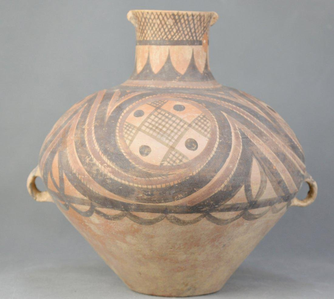 A Red Pottery Jar Decorated in Color Painting