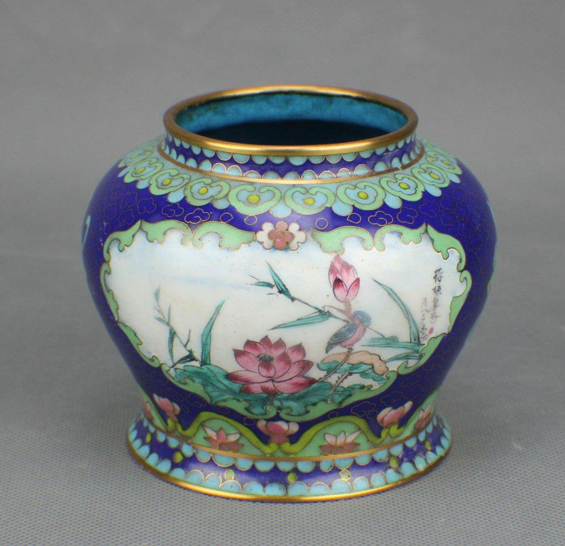A CLOISONNE JAR with ENAMEL DRAING IN FLOWER AND BIRD