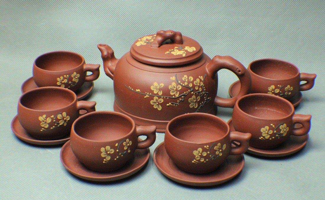 A PAIR OF TEAPOT AND CUPS MADE BY FENG XINGHUA