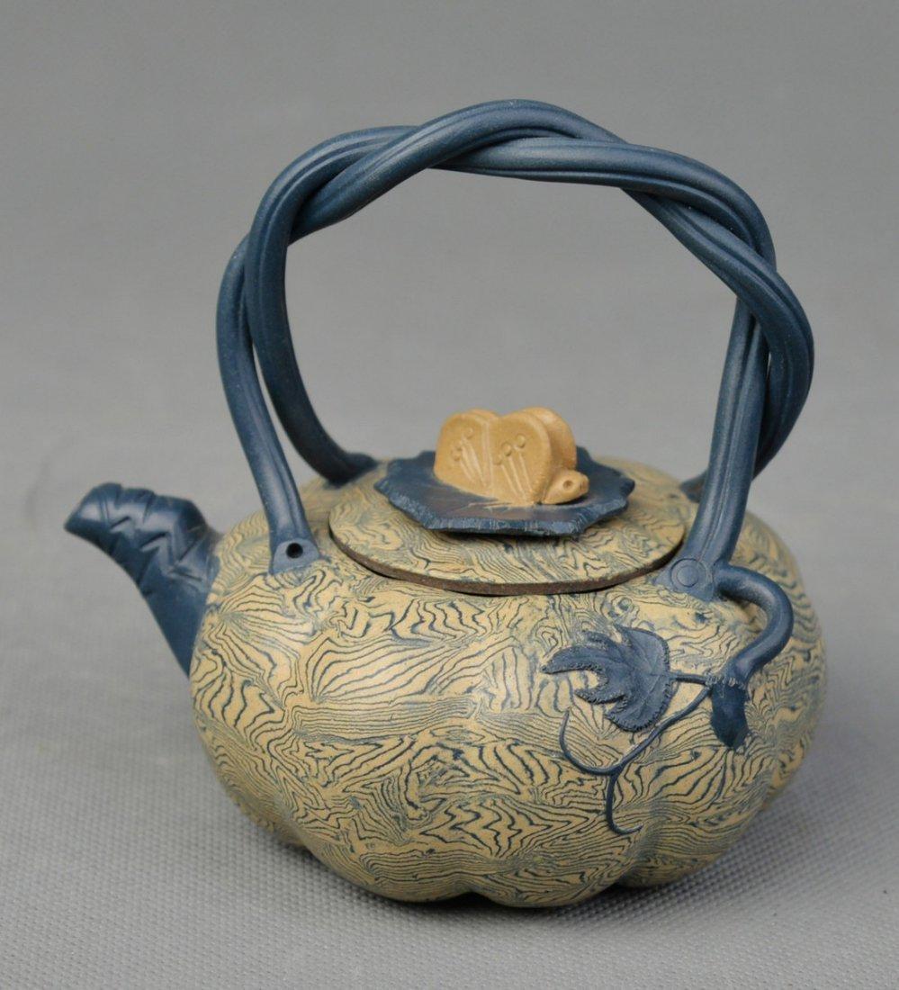 A Twistable Galzed Pumpkin Shaped Yixing Teapot by Pan