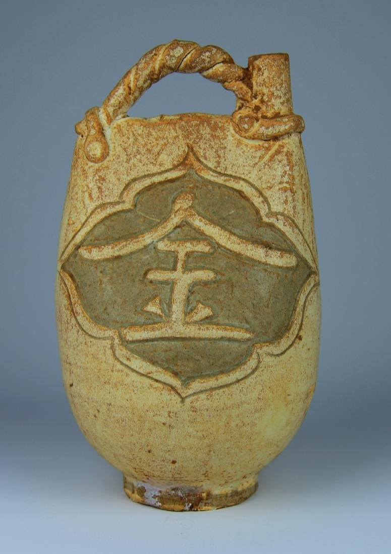 A White Glazed Handle Water-pot from  Liao-jingperiod
